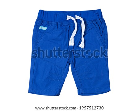 Male baby shorts close up isolated on the white background, blue pair of shorts isolated on white Royalty-Free Stock Photo #1957512730