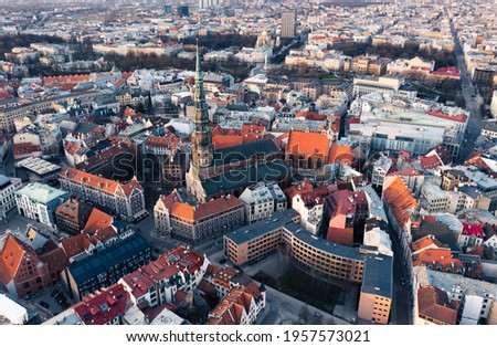 RIga rooftop view panorama at sunset with urban architectures and Daugava River. Royalty-Free Stock Photo #1957573021