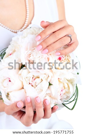 Bride holding wedding bouquet of white peonies, close-up #195771755
