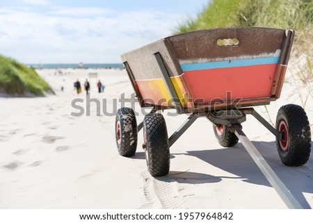 Handcart at the North Sea beach  Royalty-Free Stock Photo #1957964842