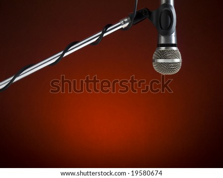 A microphone on a boom over a red background.
