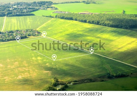 Aerial view of green field, position point and boundary line to show location and area. A tract of land for owned, sale, development, rent, buy or investment. Royalty-Free Stock Photo #1958088724