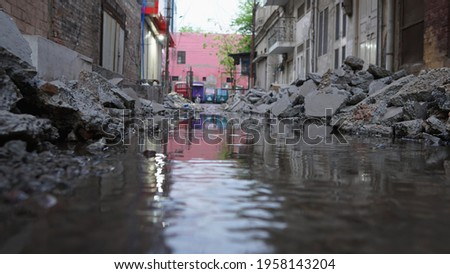 close up of street debris - close up of debris - close of debris in water - street construction Royalty-Free Stock Photo #1958143204