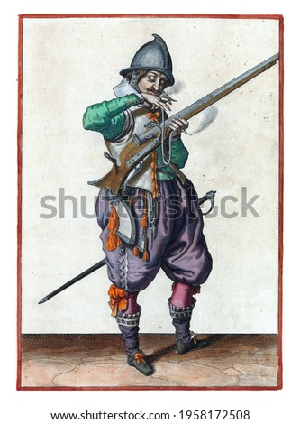 A soldier on guard, full-length, to the right, holding a rudder (a certain type of firearm) with his left hand. With his right hand he brings a burning wick to his mouth to blow it clean Royalty-Free Stock Photo #1958172508