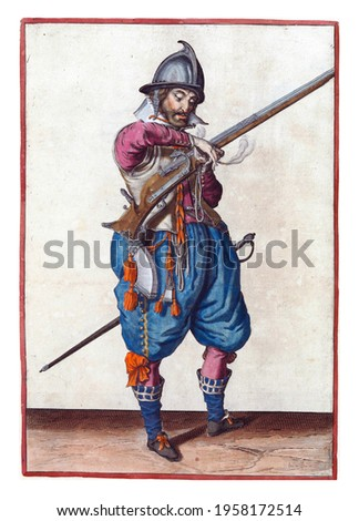 A soldier on guard, full-length, to the right, holding a rudder (a certain type of firearm) with his left hand. In his left hand, in addition to the rudder, also a burning fuse Royalty-Free Stock Photo #1958172514