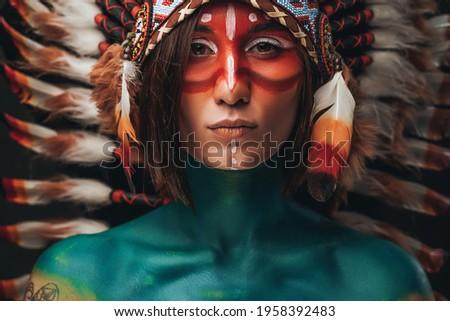 Closeup photography of a seductive woman with headdress Royalty-Free Stock Photo #1958392483