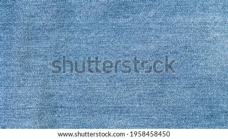 Blue denim jeans texture background. top view.