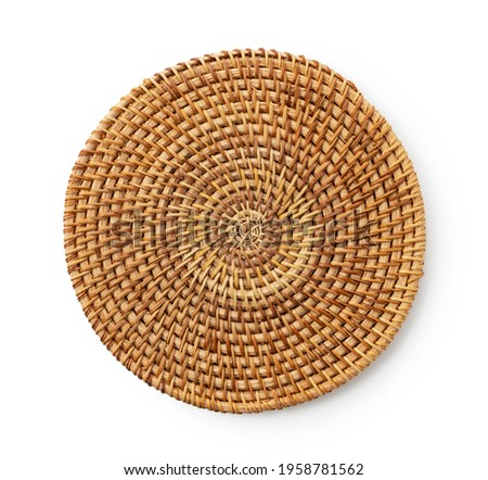 Round woven placemat placed on a white background. View from above. Royalty-Free Stock Photo #1958781562