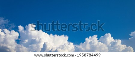 Blue sky background. Wide panorama with cumulus clouds at the bottom of the photo Royalty-Free Stock Photo #1958784499