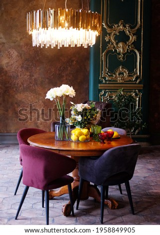 A beautiful romantic room with elegant Italian furniture, a luxurious chandelier and fresh flowers.
