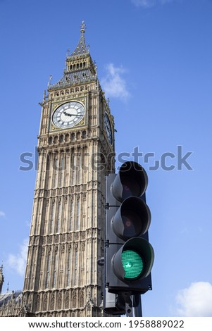 A low angle shot of green traffic light with Big Ben background in London, England