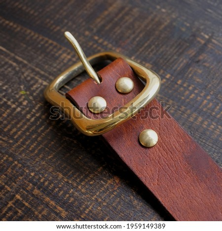 Vintage handmade Brown Men Belt Leather with brass buckle Royalty-Free Stock Photo #1959149389