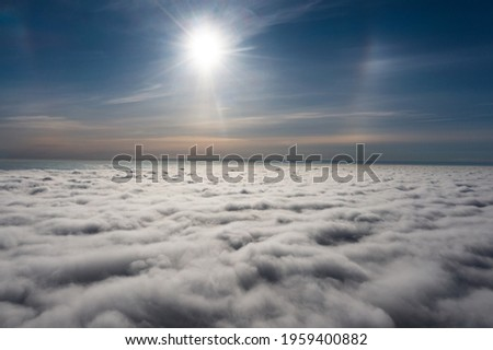 sunrise on blue sky. Blue sky with some clouds. View over the clouds. Royalty-Free Stock Photo #1959400882