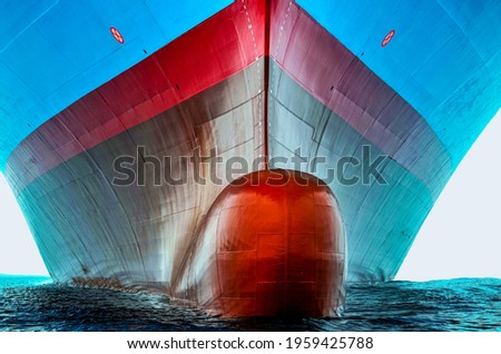 Front view of the large cargo ship bulbous bow, she is freshly painted.   Royalty-Free Stock Photo #1959425788