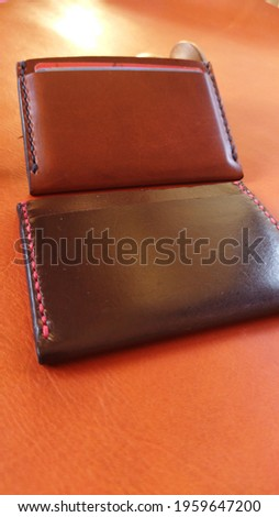 leather card holder handmade with vegetable tanned leather in natural colours. Hand stitched. Leather wallet. Men's wallet Royalty-Free Stock Photo #1959647200