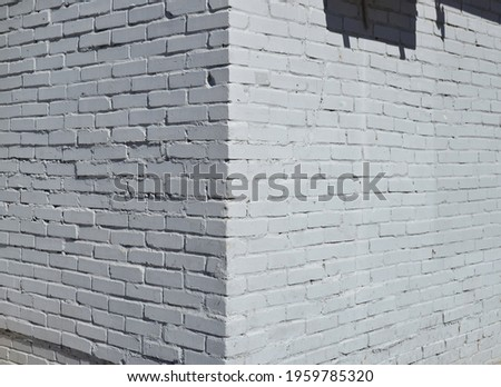 House corner, Brick wall painted with white paint. Royalty-Free Stock Photo #1959785320