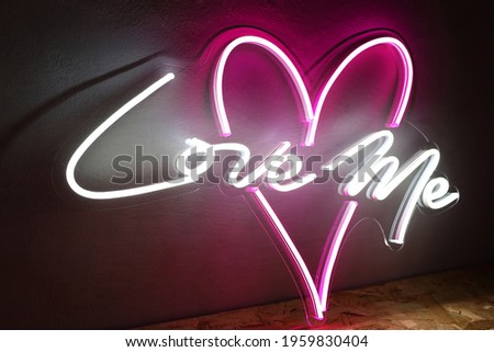 White and pink neon heart with the inscription love me. Trendy style. Wedding design. Neon sign. Custom neon. Home decor.