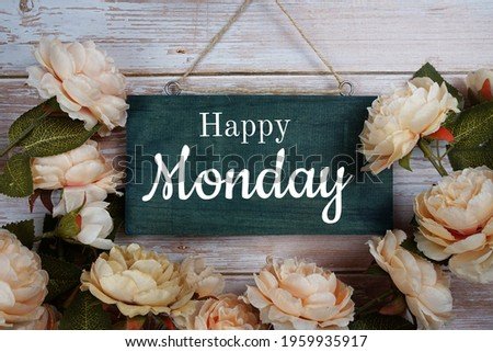 Happy Monday typography text with flower decoration on wooden background