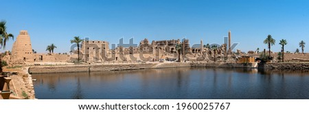 Ancient ruins of the Karnak Temple in Luxor (Thebes), Egypt. The largest temple complex of antiquity in the world. UNESCO World Heritage. Royalty-Free Stock Photo #1960025767