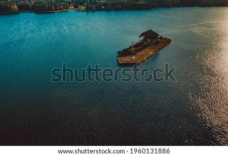 Old church isolated on an island. Royalty-Free Stock Photo #1960131886