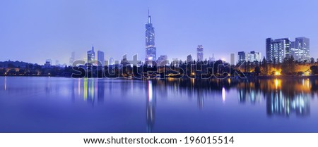 Twilight skyline reflected in calm water, Nanjing, China #196015514