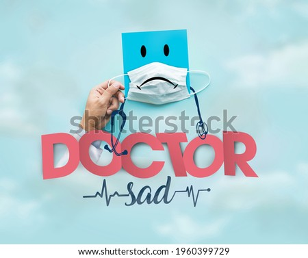 sad doctor and covid-19 mask