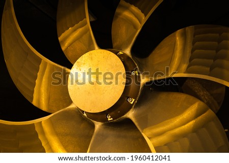 New ship's seven-blade bronze propeller, close-up. Royalty-Free Stock Photo #1960412041