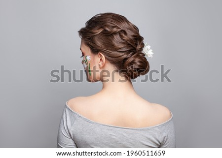 Pretty brunette woman back and head with perfect hairdo on white background