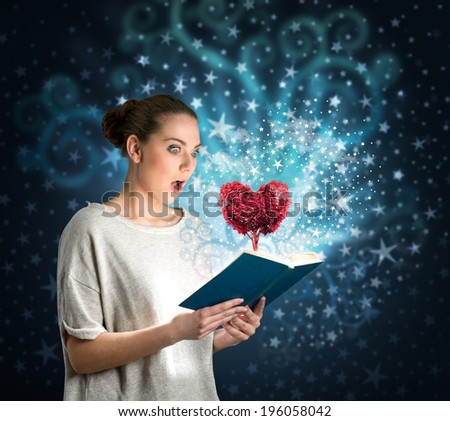 Young woman reading a magic book