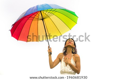 attractive and happy Asian woman holding rainbow colorful umbrella or parasol  smiling playful isolated on white background in beauty and freedom concept Royalty-Free Stock Photo #1960681930
