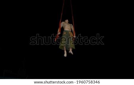 Flying acrobat on black background, spider man, Chinese circus, entertainment,  slings exercises, upward movement, extreme sport