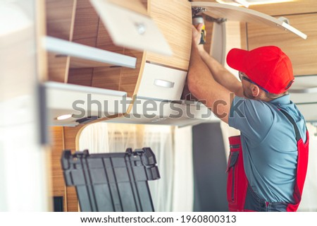 RV Recreational Vehicle Interior Finishing by Professional Worker. Building Camper Van. Royalty-Free Stock Photo #1960800313