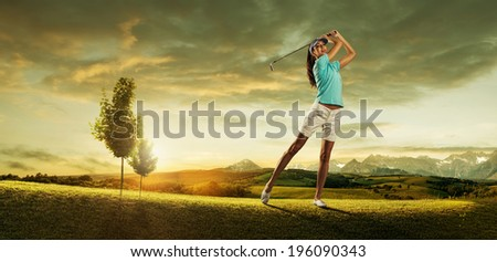 Woman golfer hitting the ball on the background scenery  beautiful #196090343