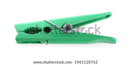 Bright green plastic clothespin isolated on white Royalty-Free Stock Photo #1961128762