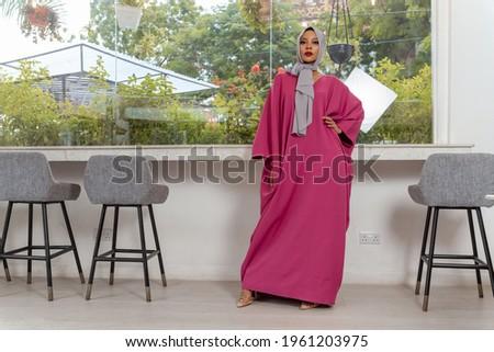 Muslim woman in stylish pink abaya Royalty-Free Stock Photo #1961203975