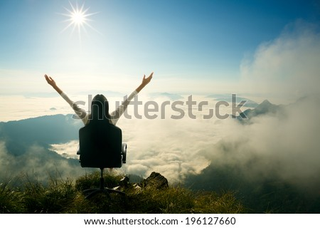 Young woman sits on a chair and open her arms at the top of the mountain, Success in business concept #196127660
