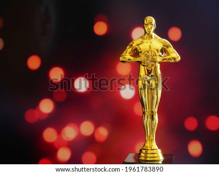 Hollywood Golden Oscar Academy award statue. Success and victory concept. Royalty-Free Stock Photo #1961783890