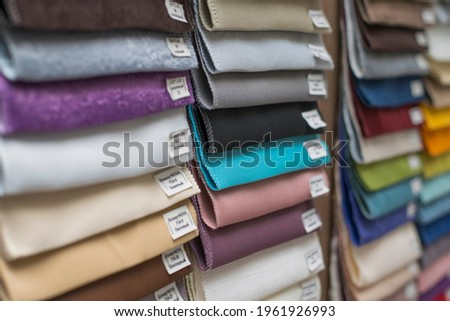 Samples of upholstery fabrics for furniture, textiles, a palette of fabrics to choose from. Soft focus Royalty-Free Stock Photo #1961926993
