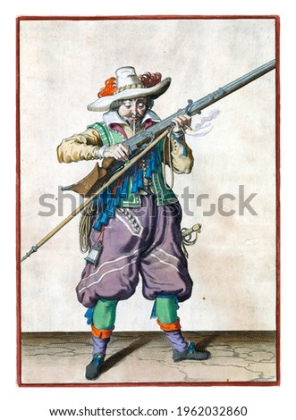 A soldier, full-length, holding a musket (a certain type of firearm) by his mouth with both hands and blowing it, in order to get rid of any powder that has fallen outside the pan Royalty-Free Stock Photo #1962032860