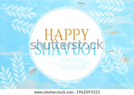 top view of blue wooden background with wheat crops. Symbols of jewish holiday - Shavuot