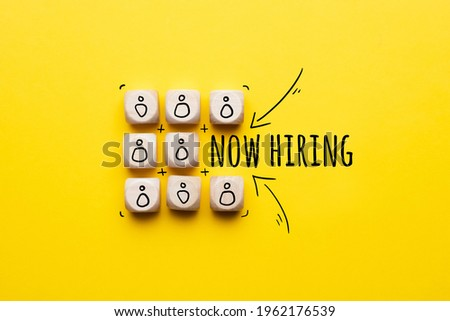 Concept is now hiring. Abstract staff icons on dice Royalty-Free Stock Photo #1962176539