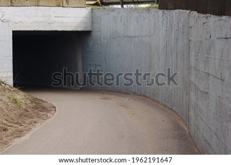 Road in tunnel, pedestrian pass Royalty-Free Stock Photo #1962191647