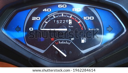 Speedometer and fuel gauge of scooter Royalty-Free Stock Photo #1962284614