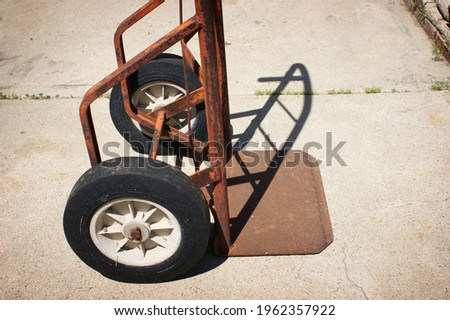 old rusted industrial handcart on concrete deck Royalty-Free Stock Photo #1962357922