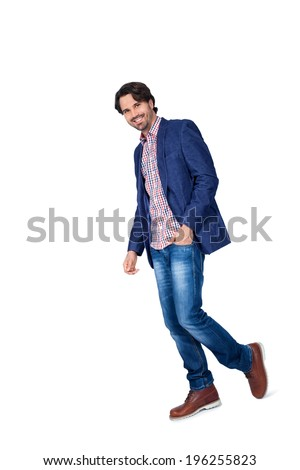 Handsome smiling man in stylish leisurewear approaching the camera in a relaxed posture with his hand in his pocket, isolated on white #196255823