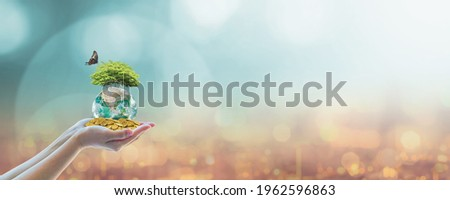 Sustainable global business investment in environment, social, governance (ESG) and CSR concept in clean industry with volunteer hands holding world green tree. Element of the image furnished by NASA. Royalty-Free Stock Photo #1962596863