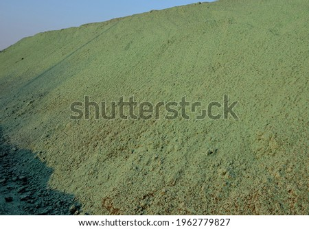 stabilization of slopes by hydro sowing. a mixture of wood pulp and green grass seed is sprayed from the tank directly onto the bare soil. creates a crust and germinating seed Royalty-Free Stock Photo #1962779827