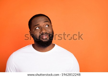Photo of attractive happy young afro american man look empty space dream isolated on orange color background Royalty-Free Stock Photo #1962812248
