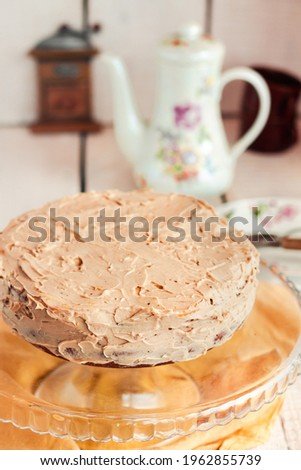Delicious round cake with white caramel and coffee buttercream.Homemade sweets for birthday. Royalty-Free Stock Photo #1962855739