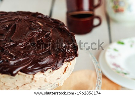 Delicious homemade dessert.Rich Dark Chocolate Cake. Moist, creamy and bitter chocolate taste. Best eaten fresh or refrigerated. Sweets for birthday concept. Royalty-Free Stock Photo #1962856174